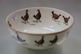 A Staffordshire bowl printed with cockfighting scenes, 19th century, probably Ashworth Brothers, the