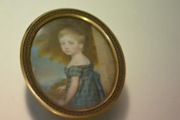 English School, early 19th century, a portrait miniature of a young child in a tartan dress,