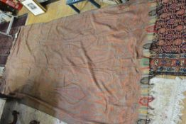 A large woollen Paisley shawl, late 19th century, worked in reds green and blue with botehs and