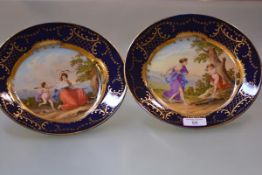 A pair of 19th century Vienna style cabinet plates, each painted to the well with a Classical