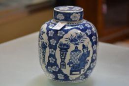 A large Chinese blue and white jar and cover, of baluster form, painted with cartouches of