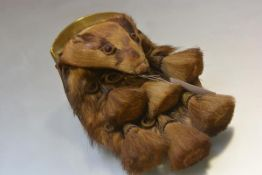 A late Victorian/Edwardian Argyll & Sutherland Highlanders badger head sporran, with brass cantle,