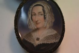 English School, c. 1840, a portrait miniature of a lady in a lace cap, watercolour on ivory, in a