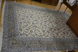 An Iranian Ziegler pattern carpet, the central panel with allover lotus flower and leaf scrolling
