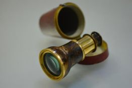 A 19th century tortoiseshell mounted gilt-brass monocular single draw opera or spy glass, in its