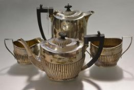 A George V three piece silver tea service, William Devenport, Birmingham 1922, each piece half