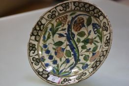 An Iznik pottery dish, Turkey, probably early 18th century, the well with characteristic