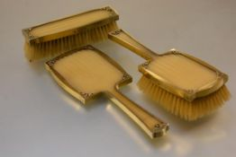 Asprey & Co., a silver-gilt partial dressing table service, London 1954, inset with ridged panels,