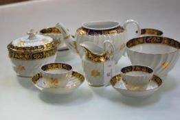 An English porcelain partial tea service, c. 1800, possibly Caughley, each piece of wrythen form,