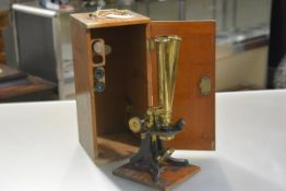 A late 19th century lacquered brass binocular microscope, Charles Collins, Great Portland Street,