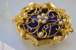 A striking Victorian diamond and seed pearl-set gold locket brooch, of shaped oval form, centred
