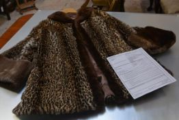 A 1940's ocelot fur coat, mid-length with beaver trimmed collar and cuffs, sold with CITES