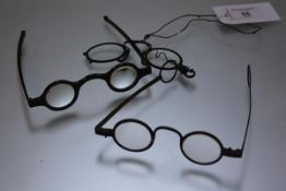 Three pairs of 19th century spectacles comprising: a tortoiseshell pince-nez; a tortoiseshell pair