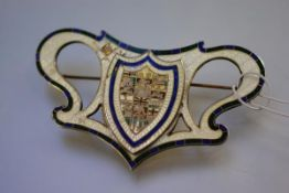 A large Canadian sterling silver and enamel brooch, c. 1900, centred by a shield with the crests