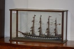 """A scratch built model of a four masted sailing ship, """"Rowena"""", fully rigged, in a glass case. Case"""