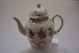 A Liverpool teapot and cover, c. 1780, of baluster form, moulded with arched panels enclosing floral