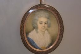 English School, c. 1800, a portrait miniature of a lady in a blue dress, watercolour on ivory, in