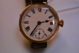 An early 18ct gold gentleman's Rolex wristwatch, the circular white enamel dial with Roman