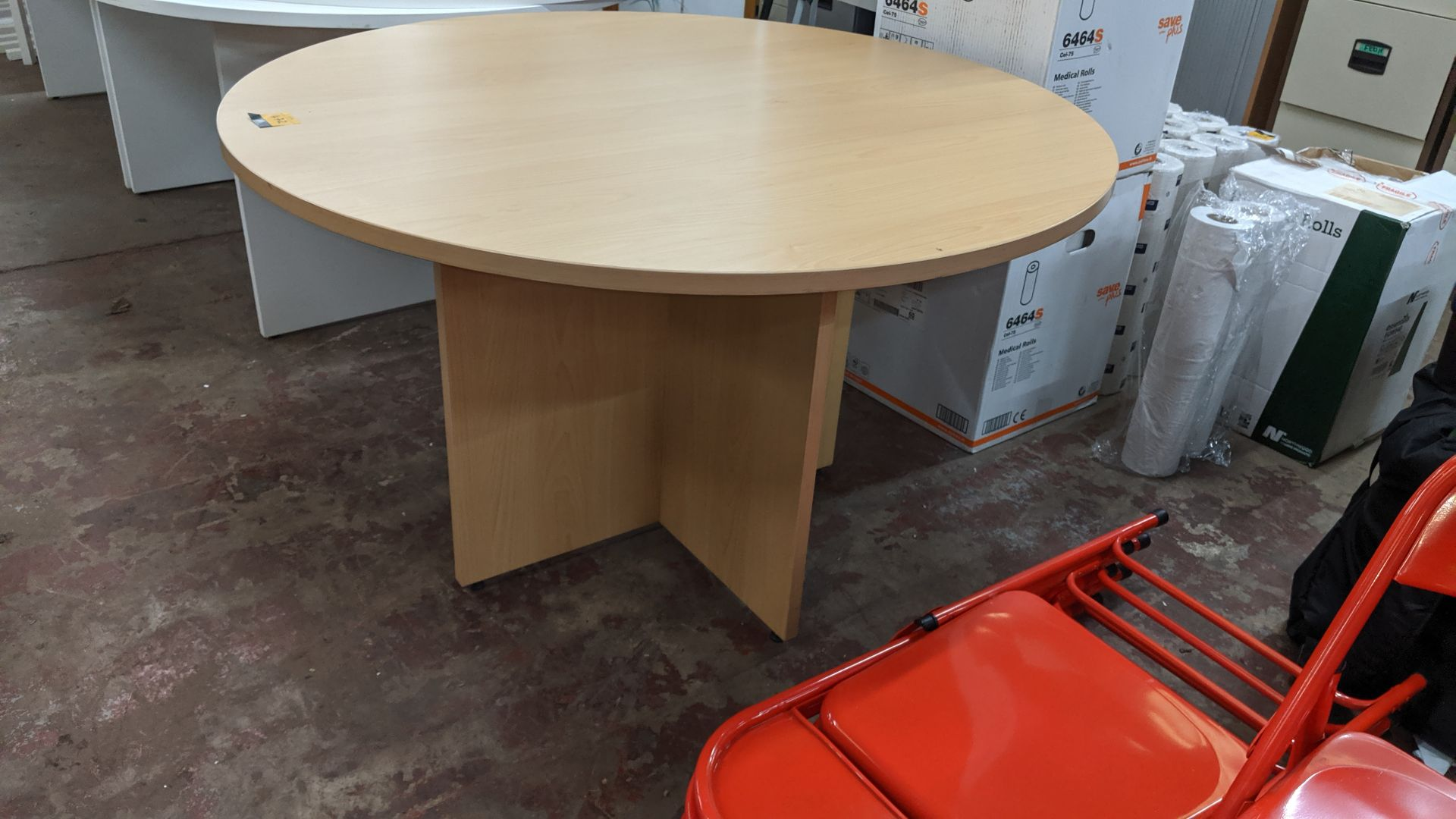 Lot 472 - Round wooden meeting table. This is one of a large number of lots used/owned by One To One (North