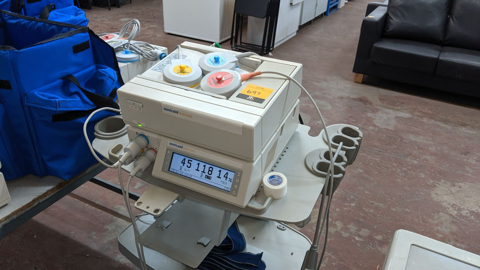 Lot 697 - Huntleigh Sonicaid Fetal scanning system comprising Team Duo & Team Care modules plus trolley, carry