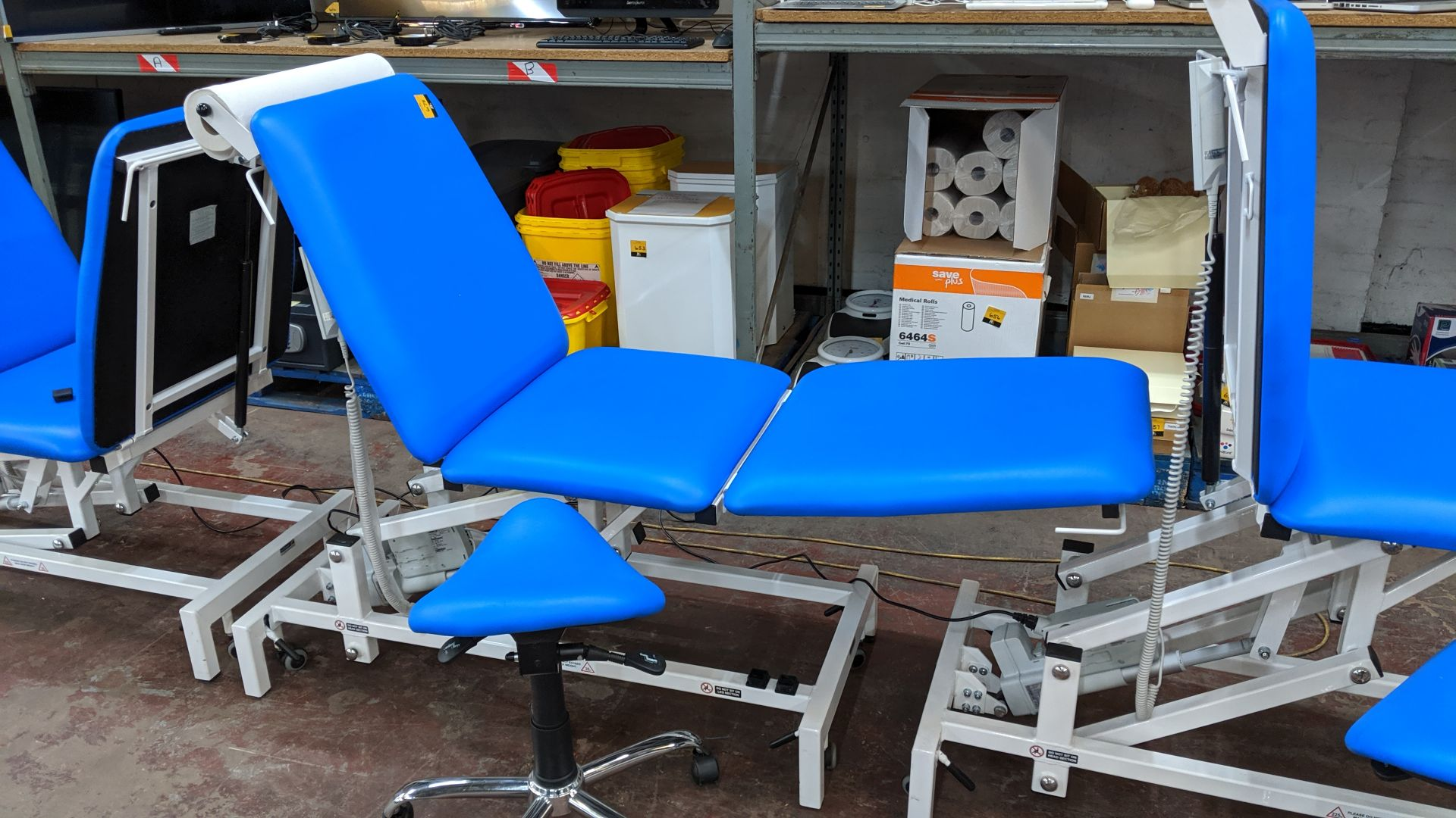Lot 678 - Sunflower Medical Equipment mobile electrically operated padded examination table with wired linak