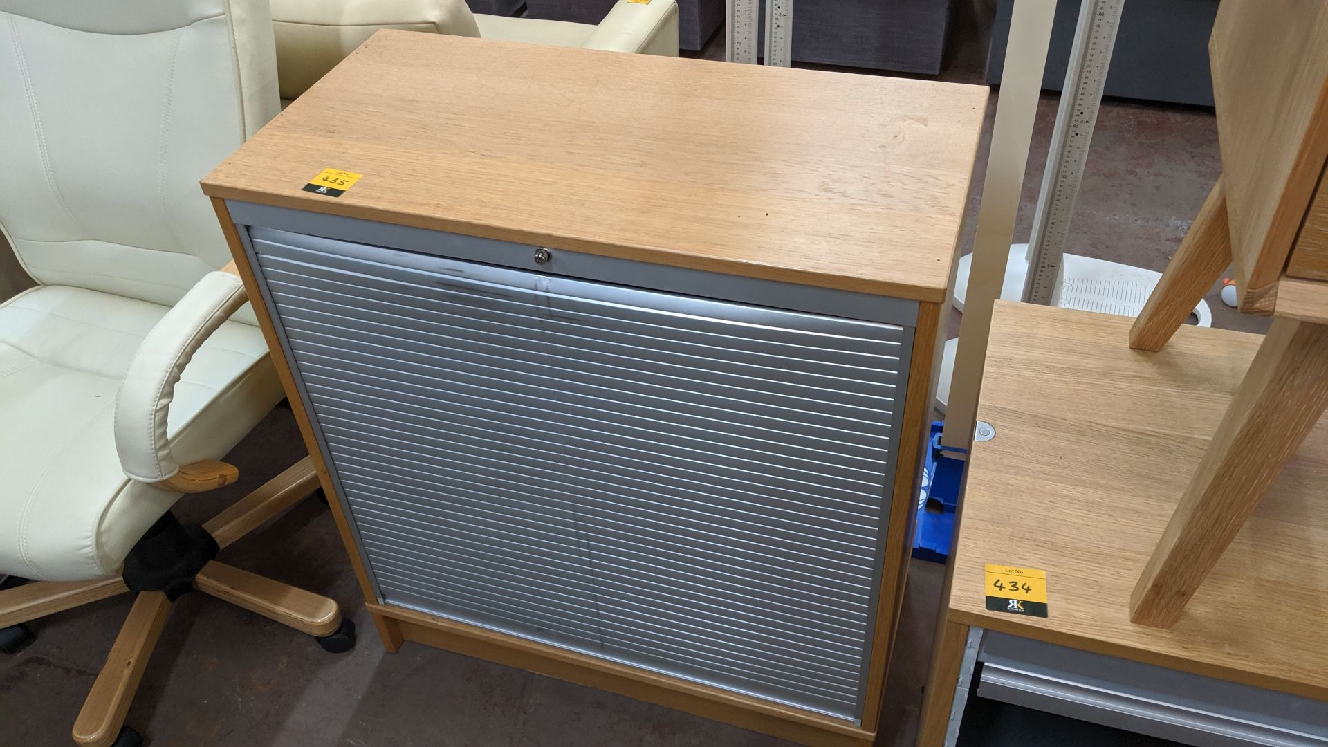 Lot 435 - Tambour-front cabinet . This is one of a large number of lots used/owned by One To One (North