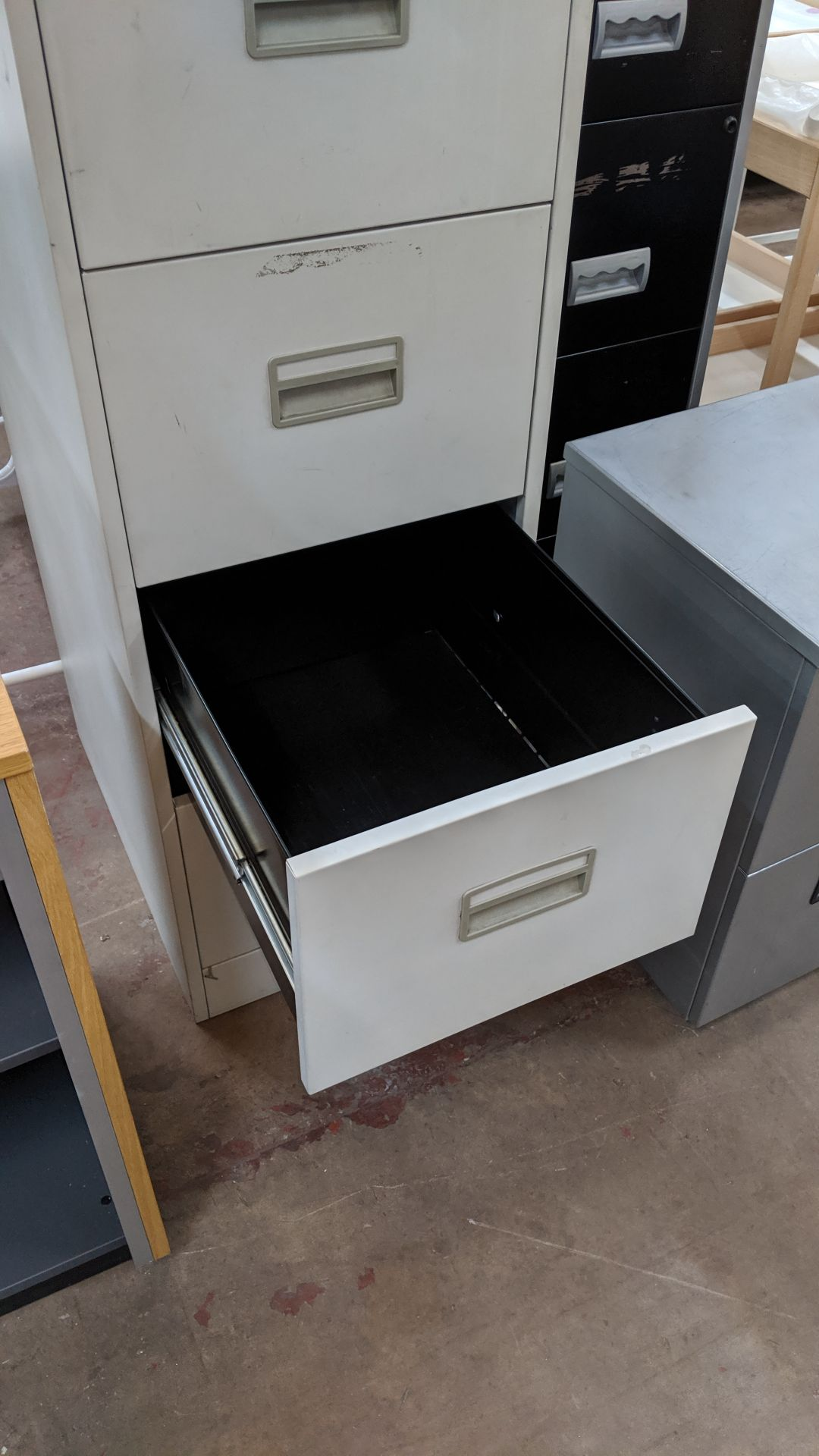 Lot 432 - Metal 4-drawer filing cabinet with key. This is one of a large number of lots used/owned by One To