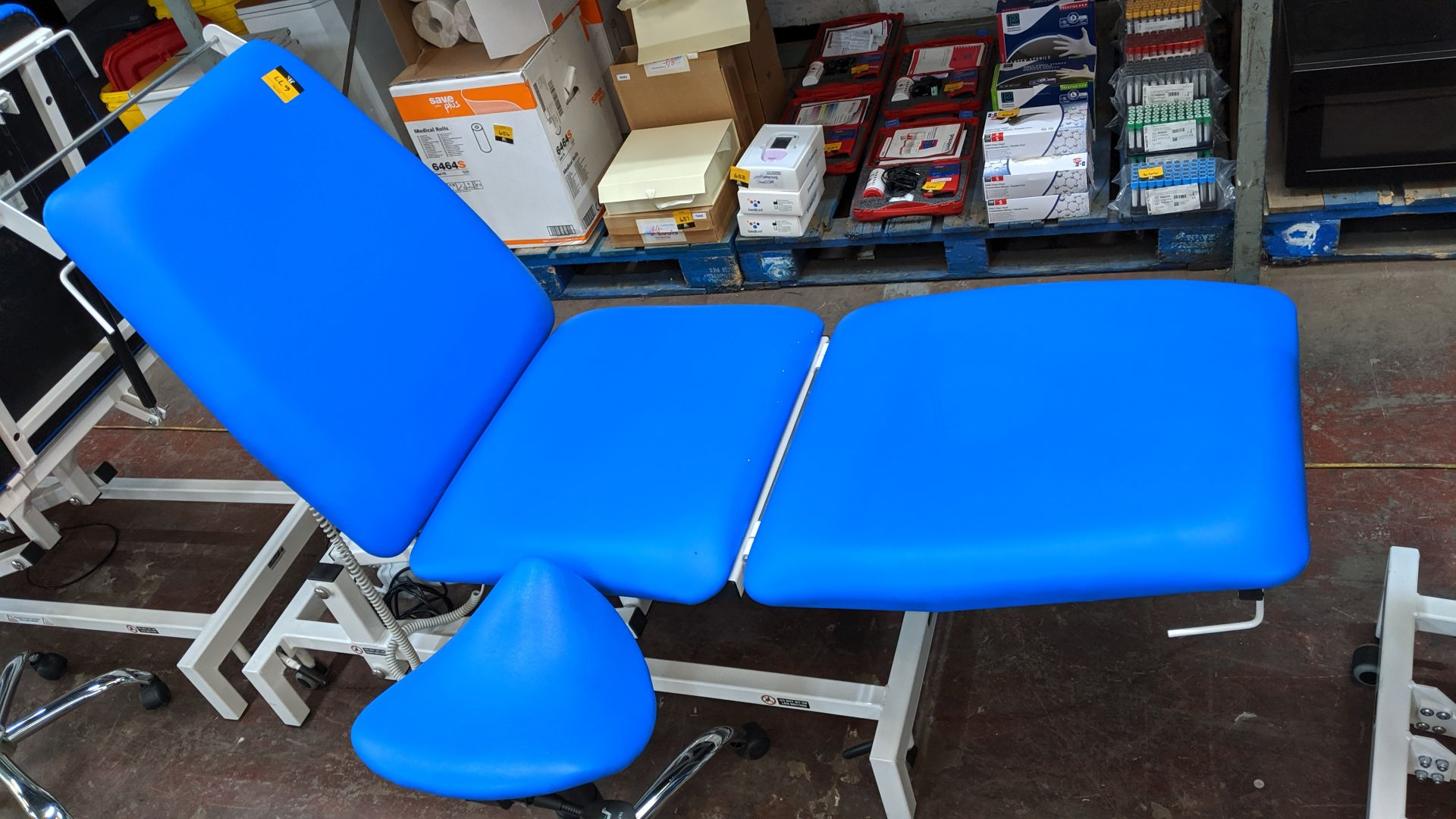 Lot 677 - Sunflower Medical Equipment mobile electrically operated padded examination table with wired linak