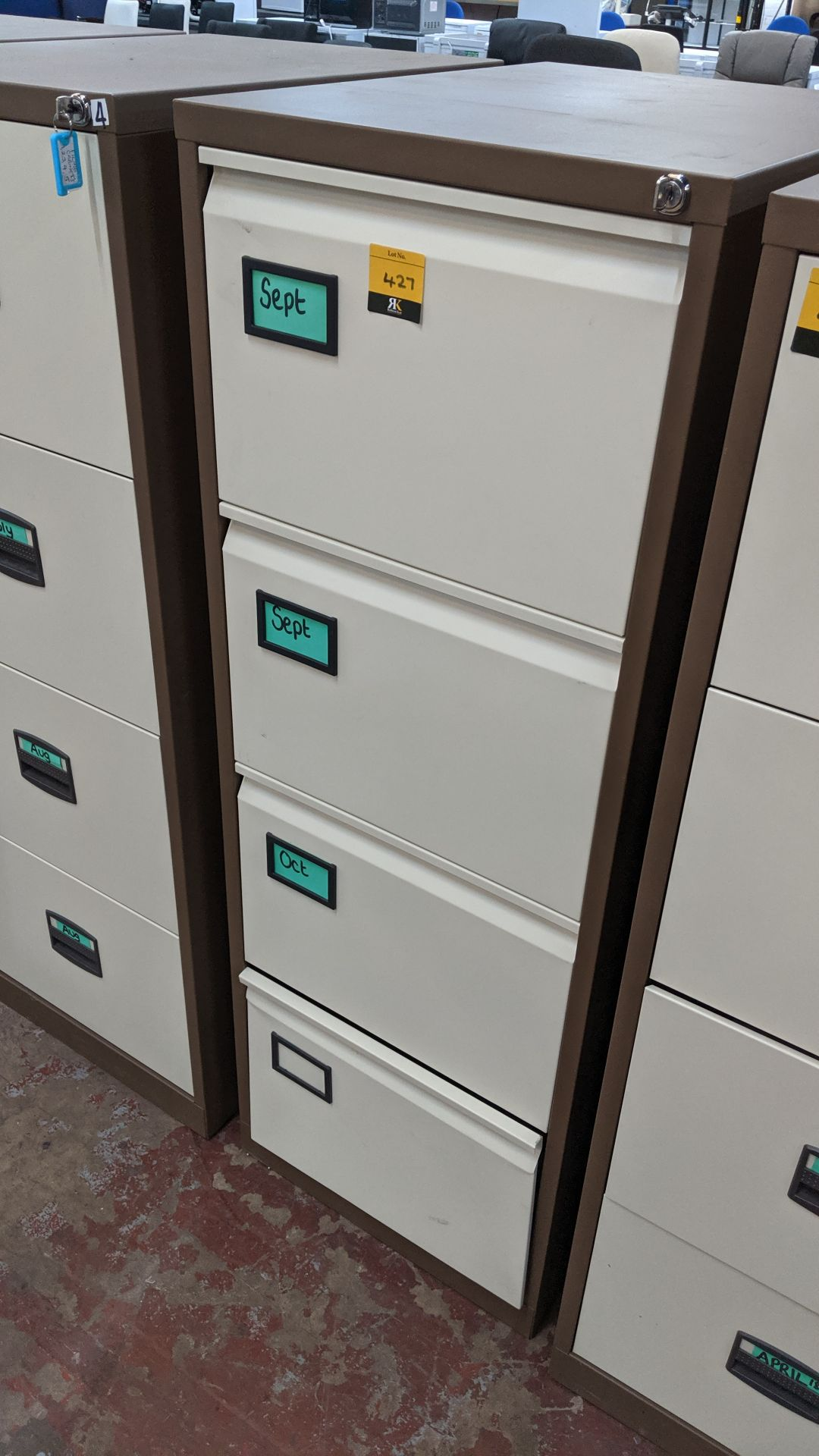 Lot 427 - Brown metal 4-drawer filing cabinet with key. This is one of a large number of lots used/owned by
