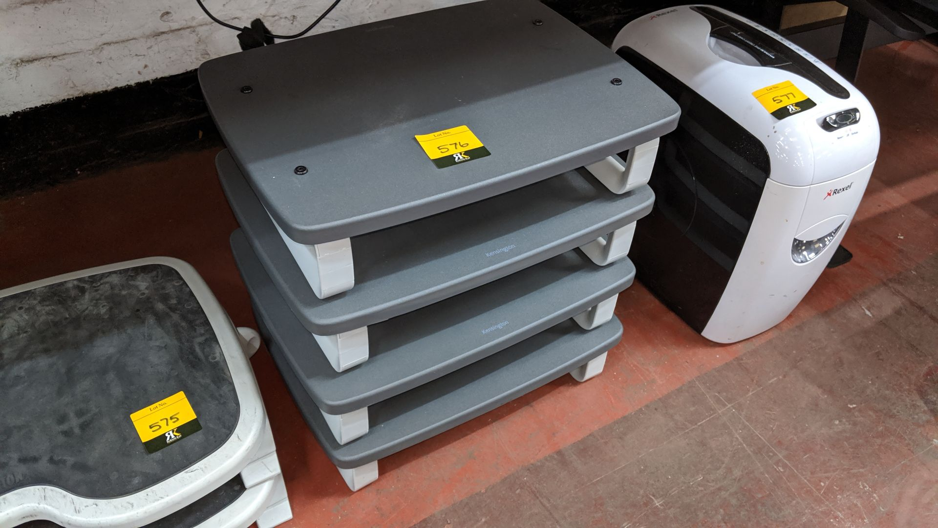 Lot 576 - 4 off Kensington monitor stands. Lots 560 - 580 form the total assets of a healthcare recruitment