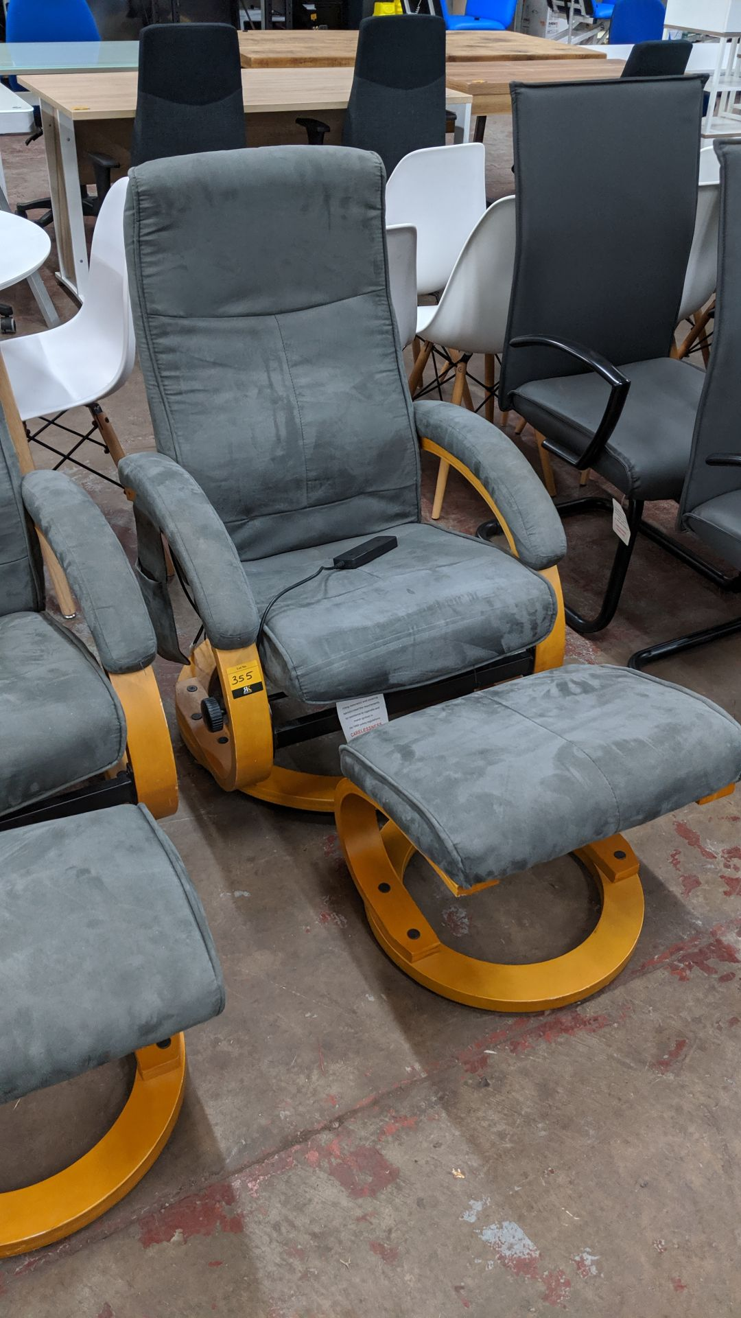 Lot 355 - Electrically operated massage reclining chair with separate footstool & pocket for holding