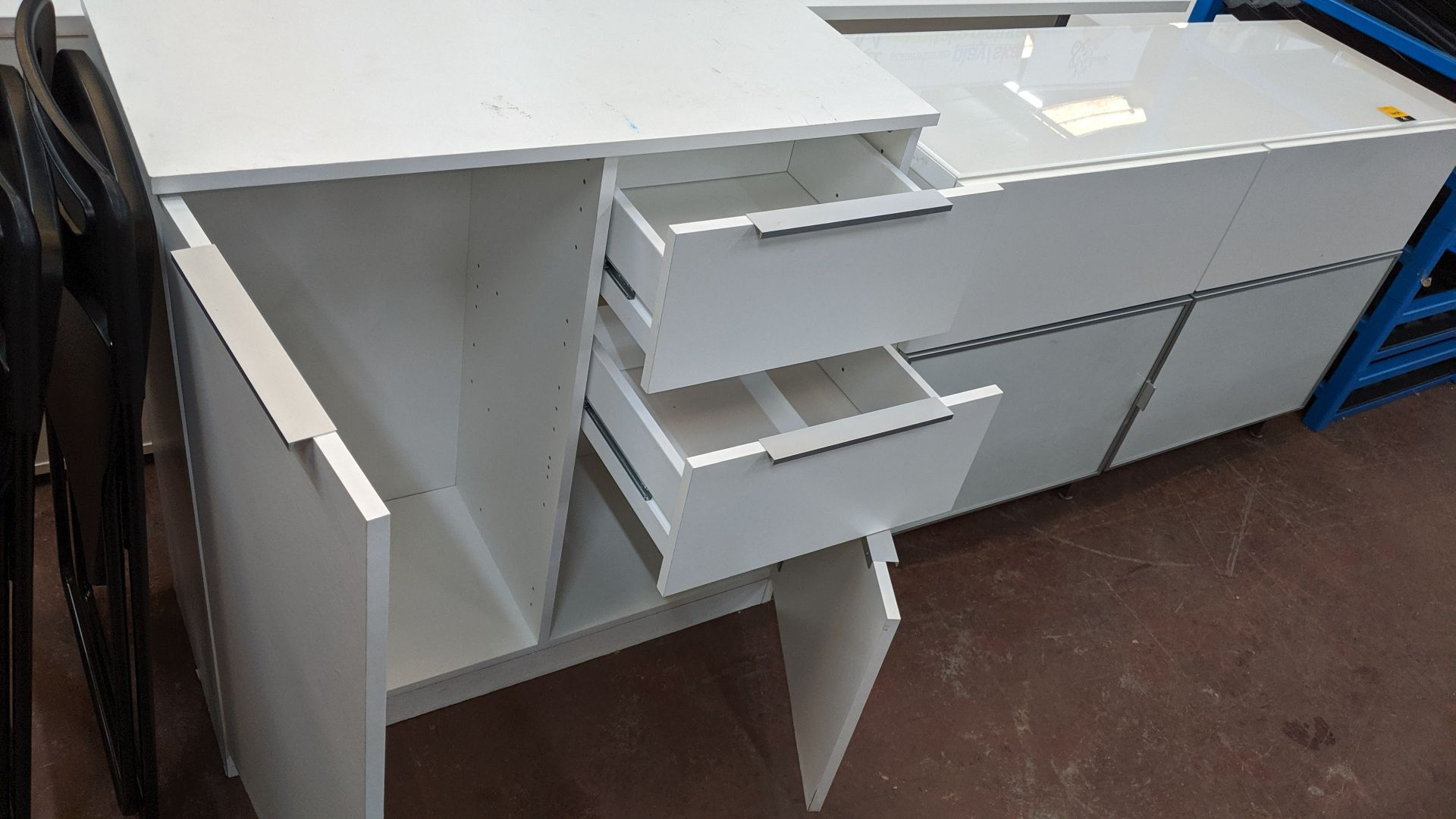 Lot 409 - 2 pieces of white storage furniture. This is one of a large number of lots used/owned by One To