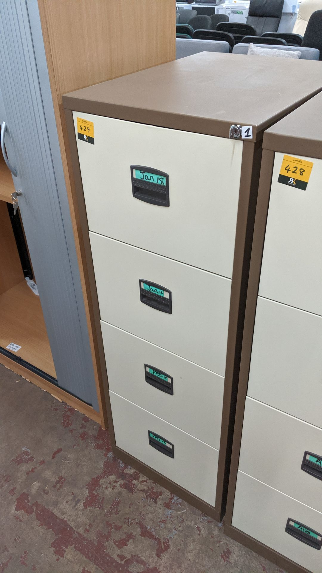 Lot 429 - Brown metal 4-drawer filing cabinet with key. This is one of a large number of lots used/owned by