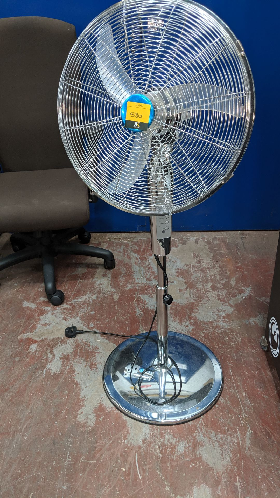 Lot 580 - Chrome finish floor standing pedestal fan with remote control. Lots 560 - 580 form the total