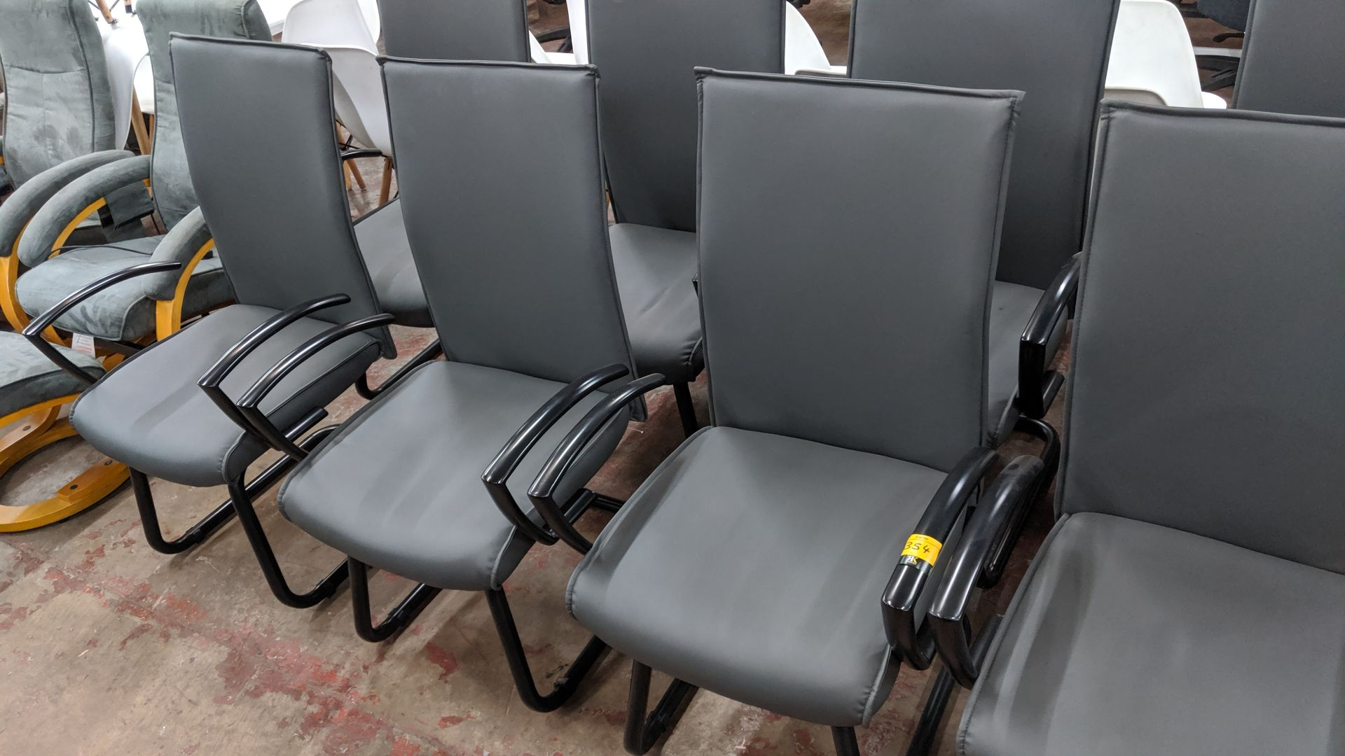 Lot 354 - 6 off black metal cantilever framed executive/meeting chairs with grey leather-look upholstery NB.