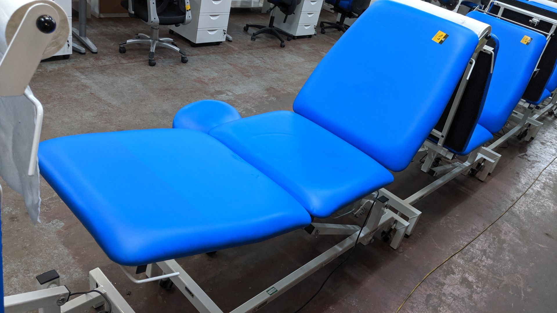Lot 676 - Sunflower Medical Equipment mobile electrically operated padded examination table with wired linak