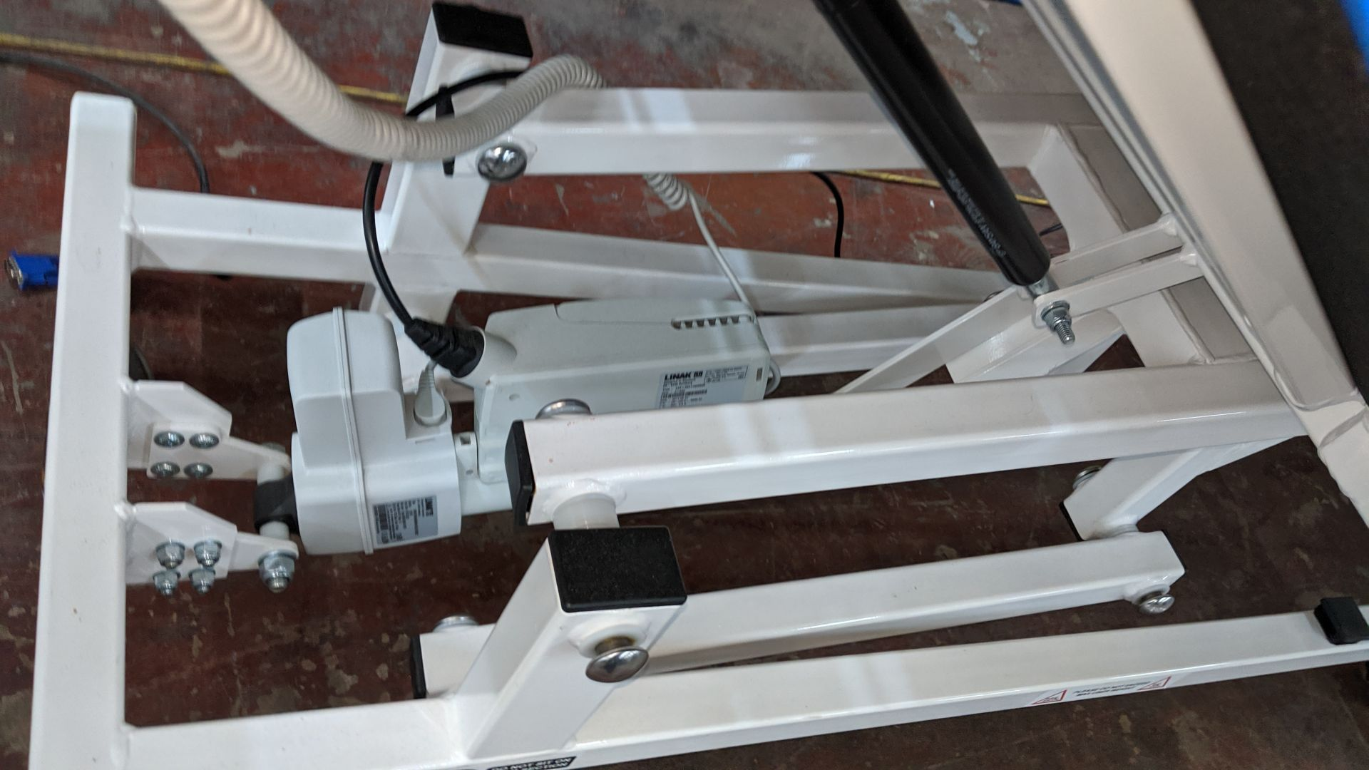 Lot 679 - Sunflower Medical Equipment mobile electrically operated padded examination table with wired linak