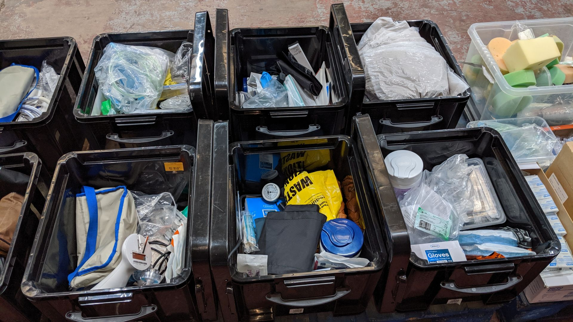 Lot 585 - Contents of 6 crates of assorted medical supplies including blood pressure monitoring equipment,