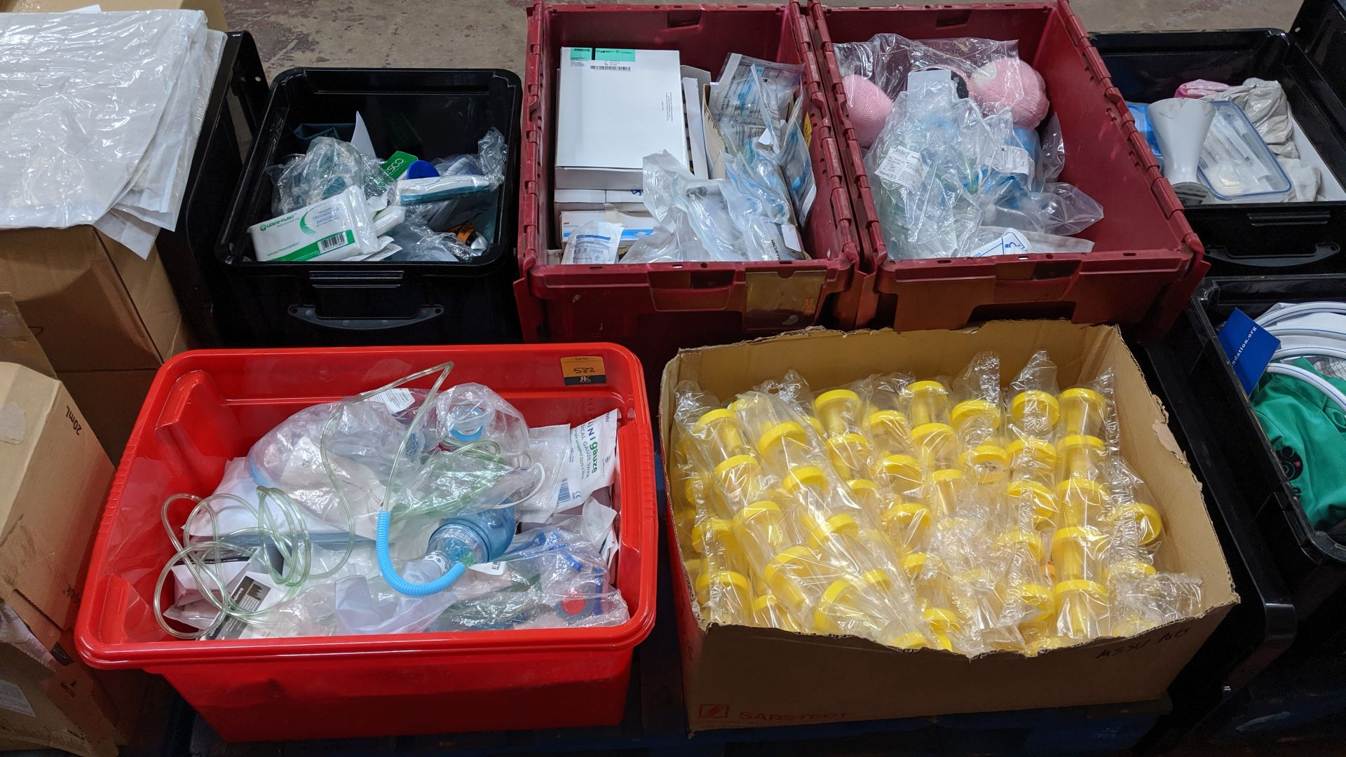 Lot 582 - Contents of a pallet of assorted medical supplies including single use resuscitators, beakers,