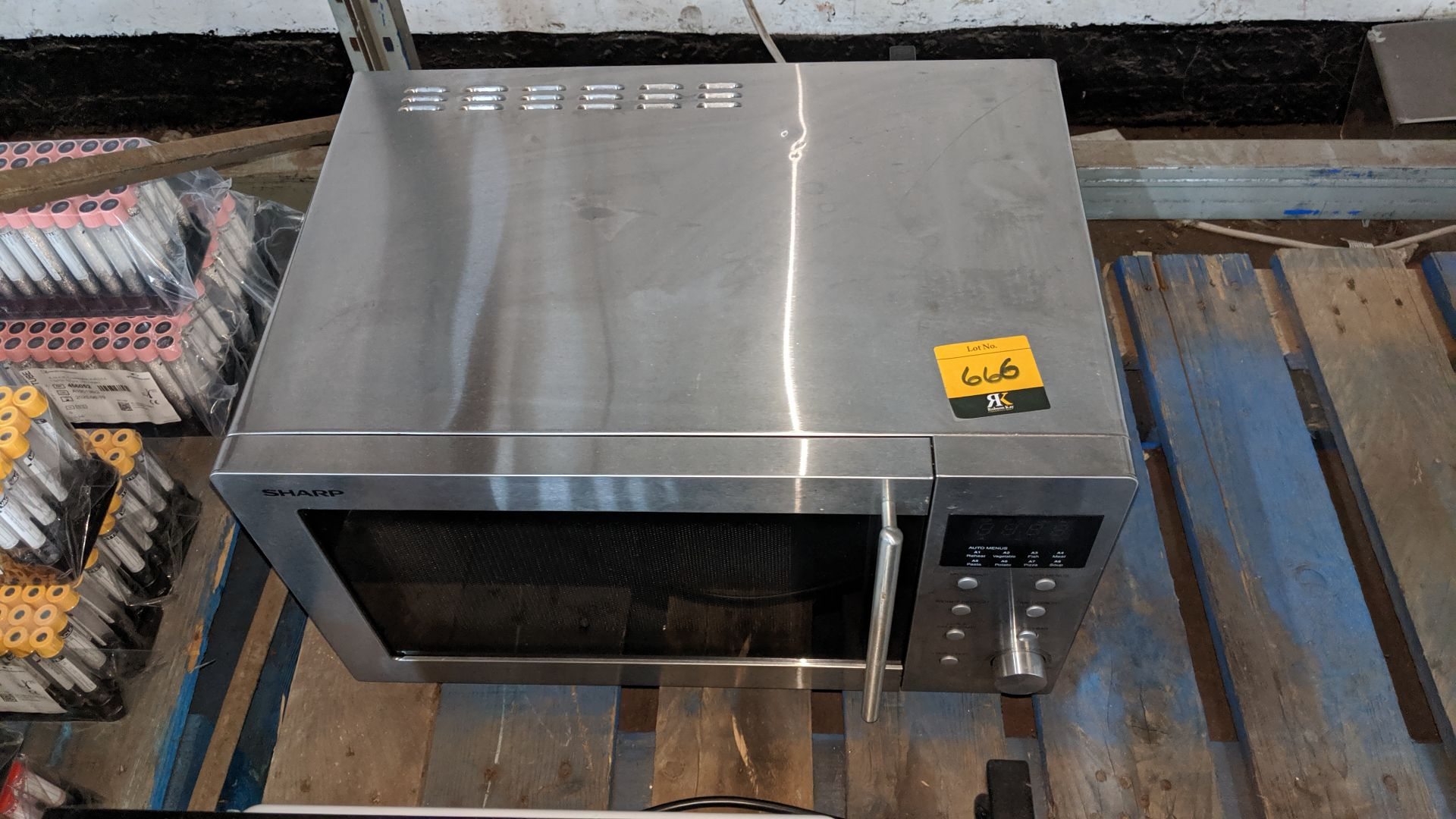 Lot 666 - Sharp stainless steel microwave. This is one of a large number of lots used/owned by One To One (