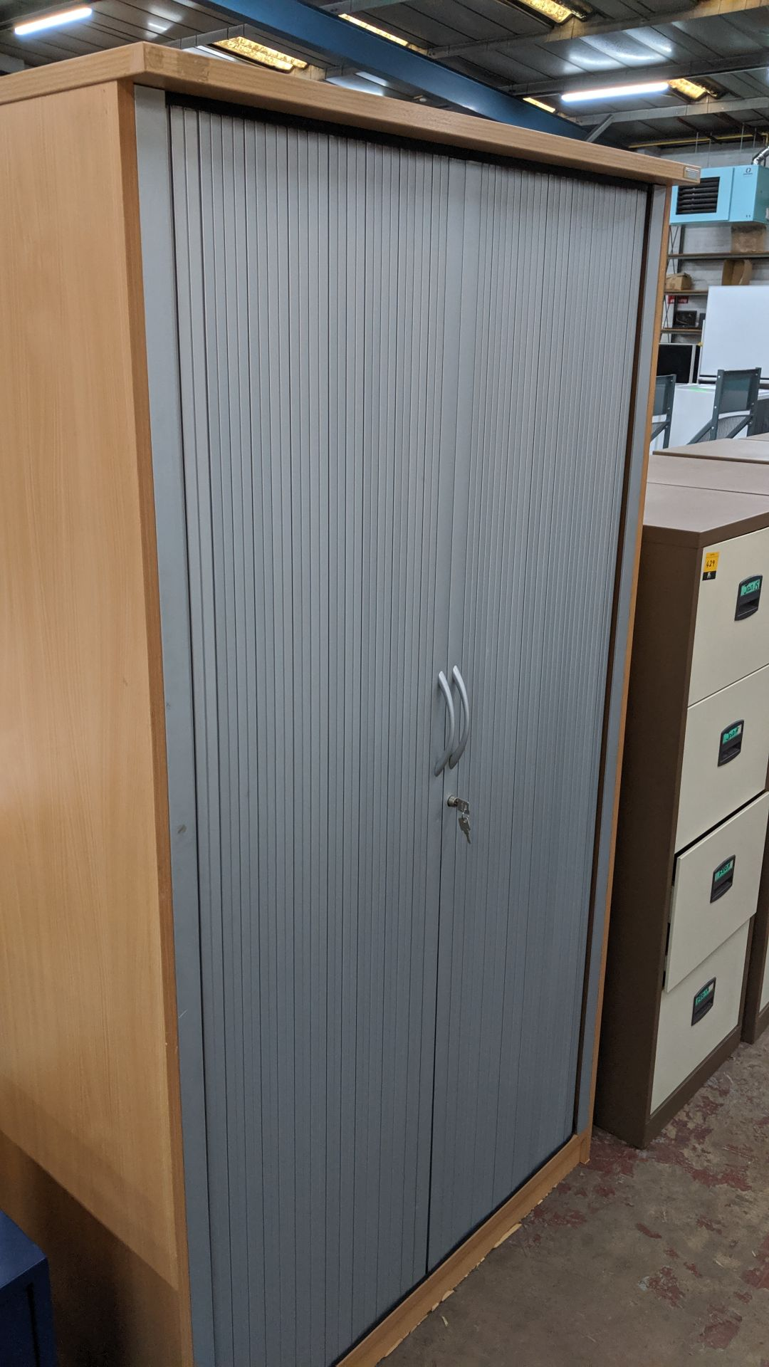 Lot 430 - Tambour-front tall stationery cupboard with key. This is one of a large number of lots used/owned by