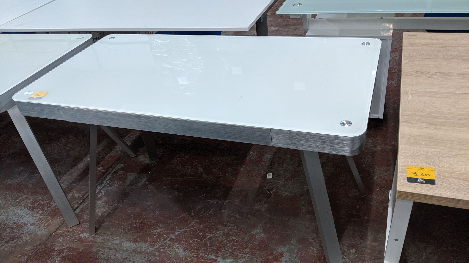 Lot 321 - Pair of matching modern glass & silver metal desks. This is one of a large number of lots used/owned