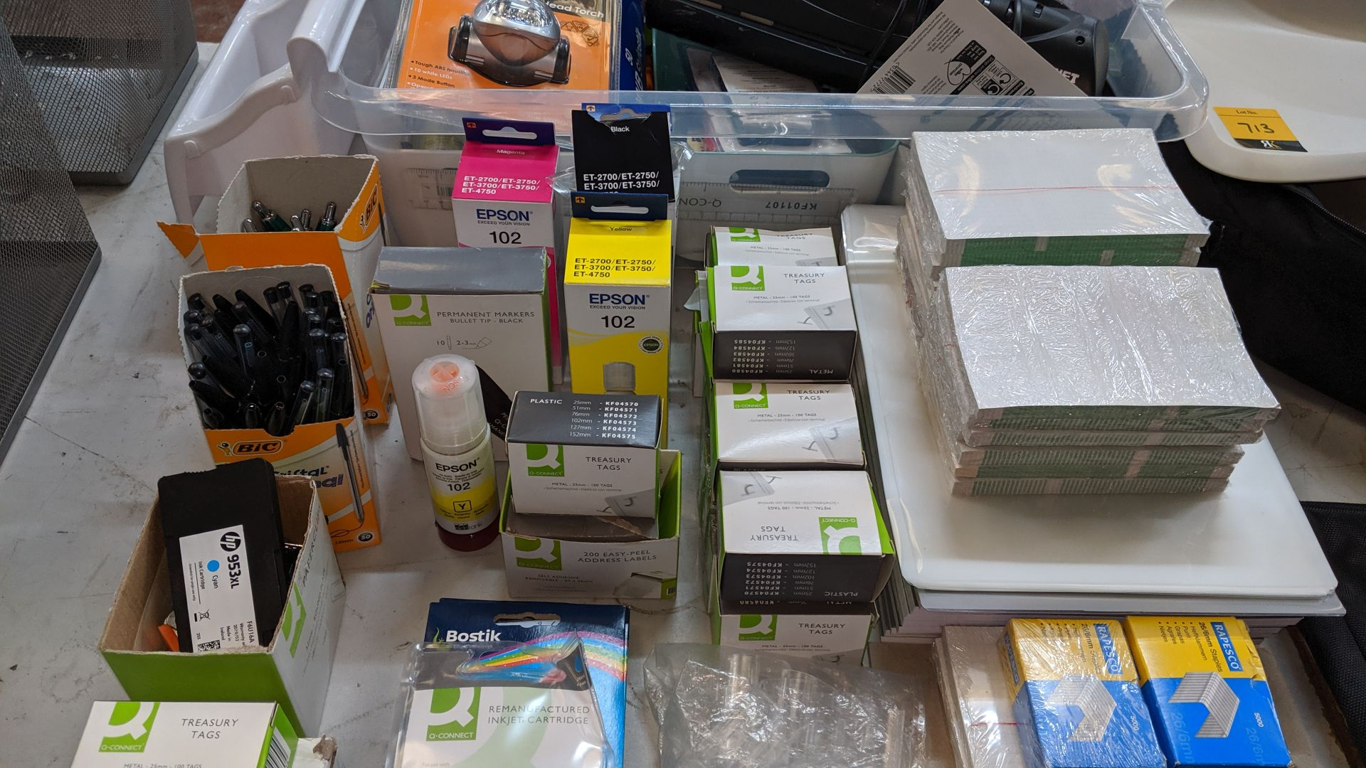 Lot 714 - Row of assorted office sundries & consumables - plastic crate excluded. This is one of a large