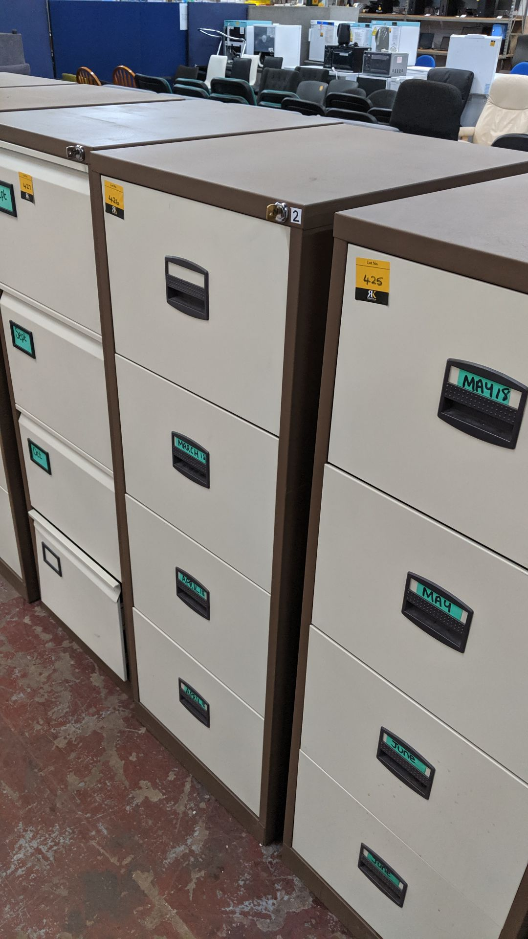Lot 426 - Brown metal 4-drawer filing cabinet with key. This is one of a large number of lots used/owned by