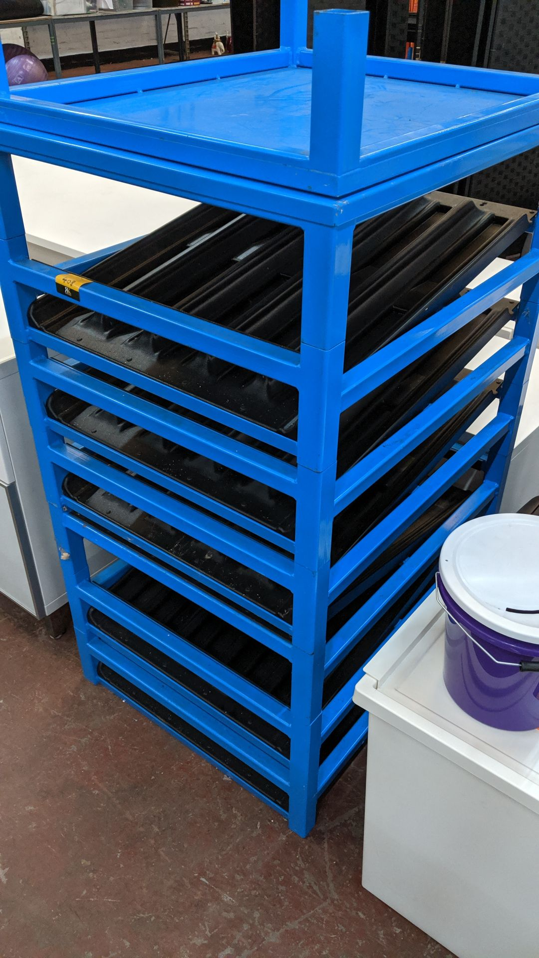 Lot 408 - Blue metal rack understood to have been used for the storage of oxygen cylinders. This is one of a