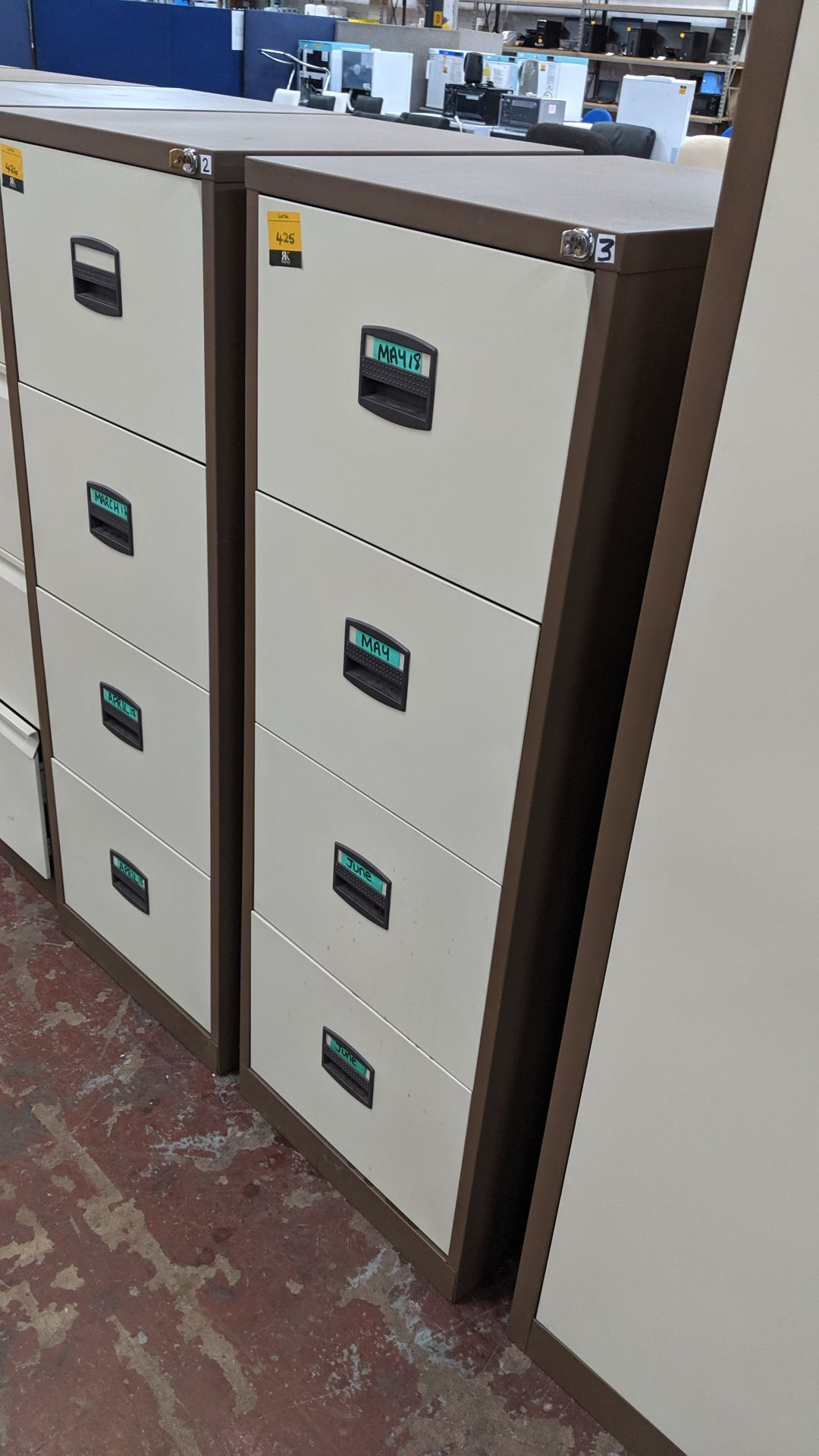 Lot 425 - Brown metal 4-drawer filing cabinet with key. This is one of a large number of lots used/owned by