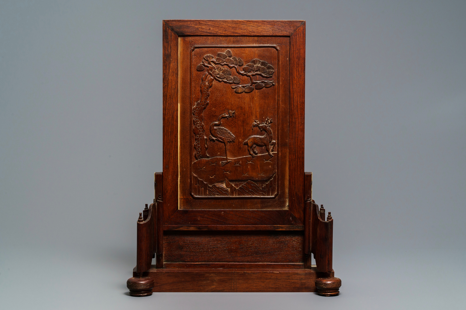 Lot 8 - A fine Chinese grisaille 'winter landscape' plaque in a wooden table screen, Republic, 20th C.