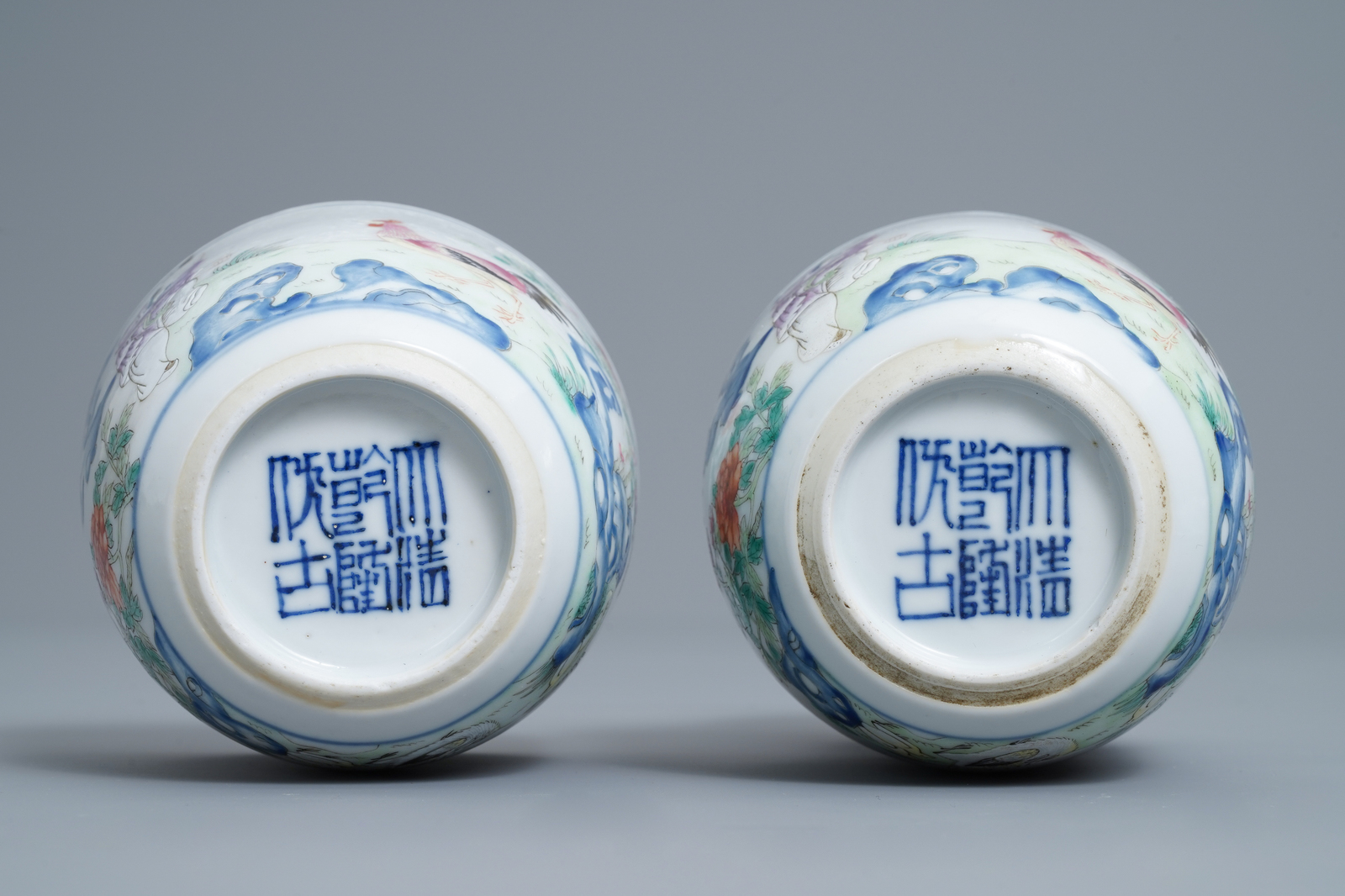 Lot 13 - A pair of Chinese famille rose 'chicken' cups, Qianlong mark, late Qing or Republic