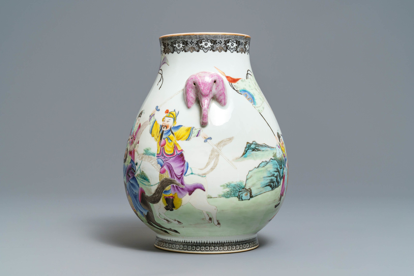 Lot 9 - A Chinese famille rose hu vase with warriors on horseback, Qianlong mark, Republic, 20th C.
