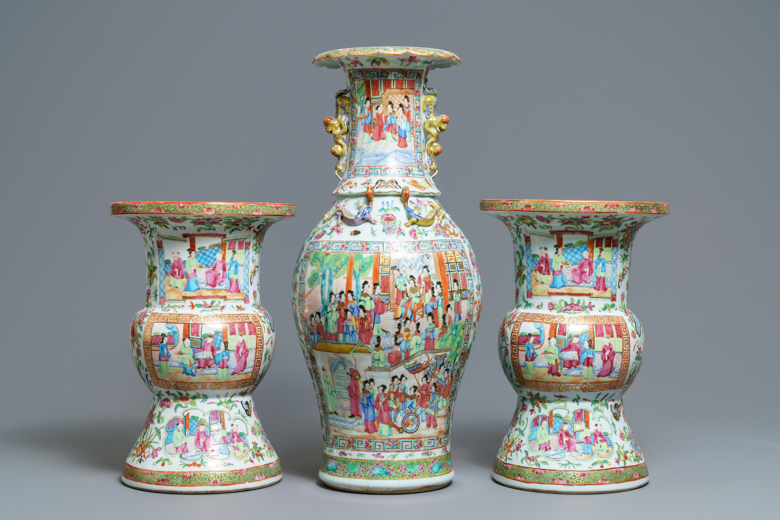 Lot 54 - A pair of Chinese Canton famille rose spittoons and a vase, 19th C.